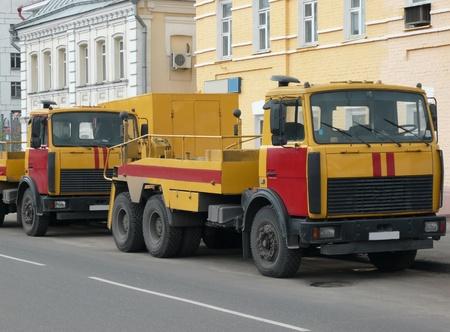 red-yellow emergency truck on asphalt road photo