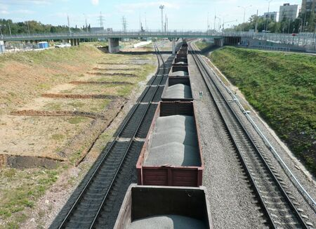 goods train with bulk cargo at summer sunny day photo
