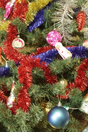 many of toys on green christmas fir Stock Photo - 13737466