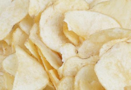 serrate: Close up of a heap of potato chips