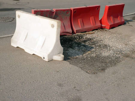 restrictive blocks on road repair at dry sunny day photo