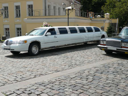 white wedding limousine  at day on street photo