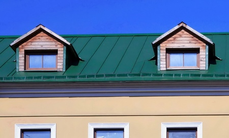 green roof on on house with wood garret Stock Photo - 14151752