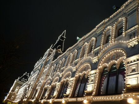 old building at winter night photo
