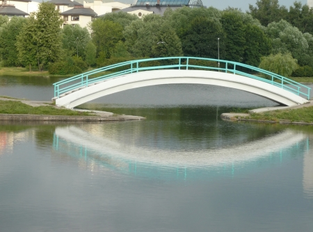 bridge over pond in city park   photo