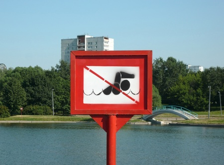 swim prohibitory sign at summer sunny day photo