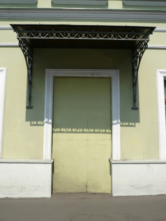 entresol: old yellow wall with door shape Stock Photo