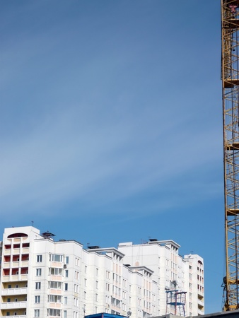 house develop with crane at day photo
