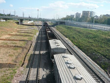goods train with bulk cargo at sunny day photo