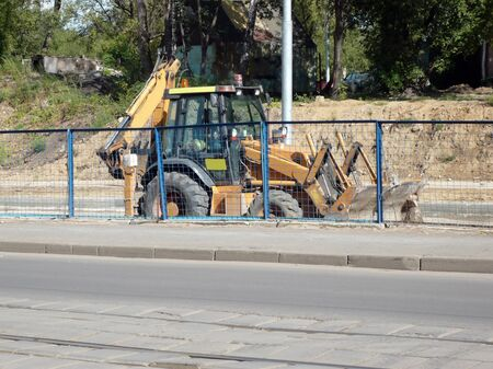 wheeled: wheeled excavator on ground at sunny day Stock Photo