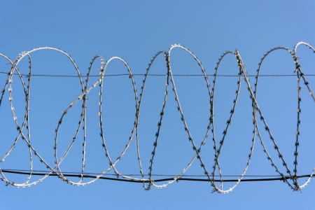 barbwire on sky background photo
