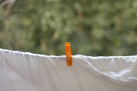 bedsheet: clothespin on white bedsheet Stock Photo