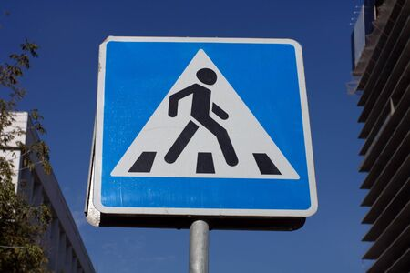 pedestrian crossing sign on street photo