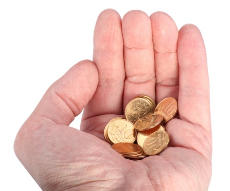 Hand with Copper Coins Isolated photo