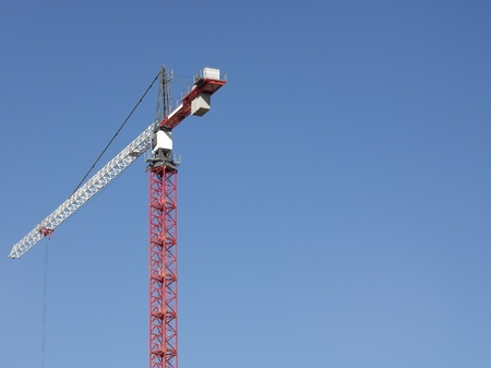 costruction: Crane Tower on Sky Background Stock Photo