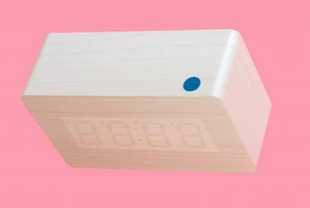 Electronic Clock Isolated on Pink Background photo