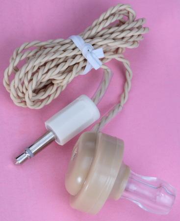 telltale: Plastic Headphones on Pink Background