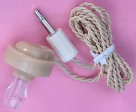 radio unit: Plastic Headphones on Pink Background