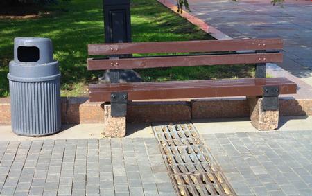 sordid: Bench in Park Stock Photo