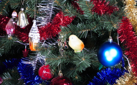 toys on green christmas fir photo