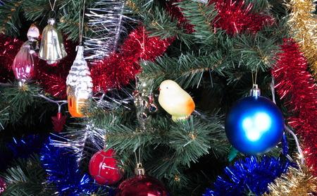 toys on green christmas fir photo
