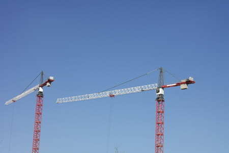 Crane Towers on Sky Background photo