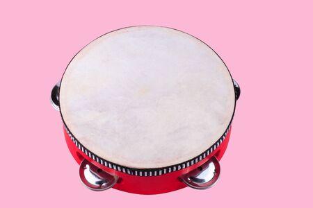 tambourine isolated on pink photo