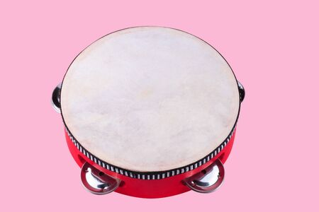 tambourine isolated on pink photo