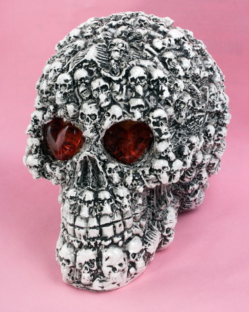 skull head toy on pink background