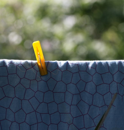 one sheet: one clothespin on blue bedsheet