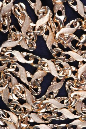 yellow Gold Chain on black fabric