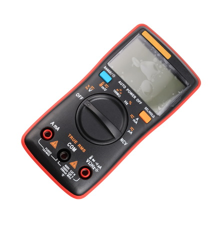 black digital multimeter isolated on white background at dry day