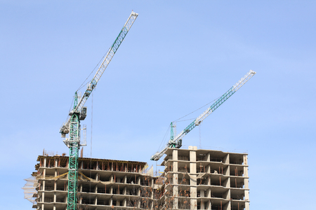 building develop with crane at day Фото со стока