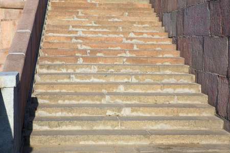 marble stairs on quay on river
