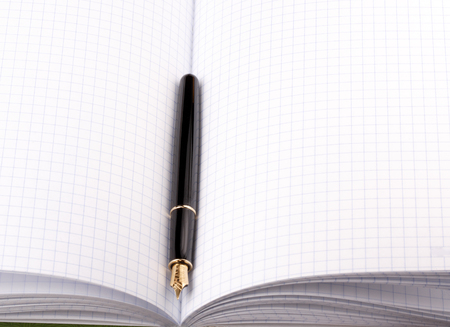 fountain pen on paper notebook Stock Photo