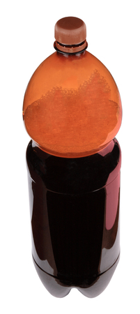kvass in bottle with brown cup isolated