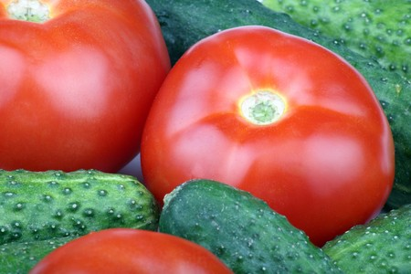 green cucumber and red tomato