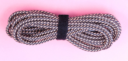 brown Aux Stereo Audio Cable on pink background Stock Photo