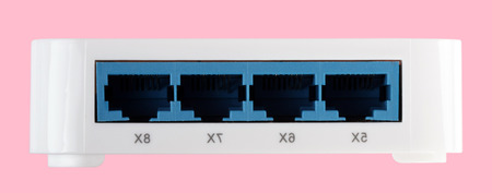 White 8 Port Plastic Switch isolated on pink background at dry day Imagens
