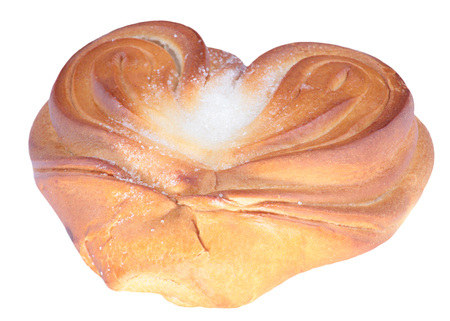 twist bun with heart shape on white 写真素材