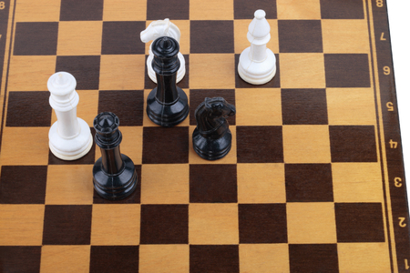 wooden checkerboard with figures