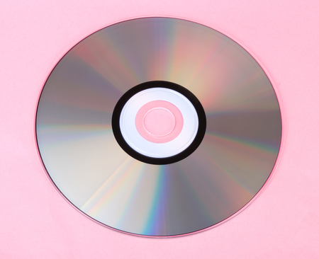 compact disc on pink background