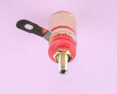 Speaker connector on pink background