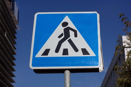 pedestrian crossing sign on street