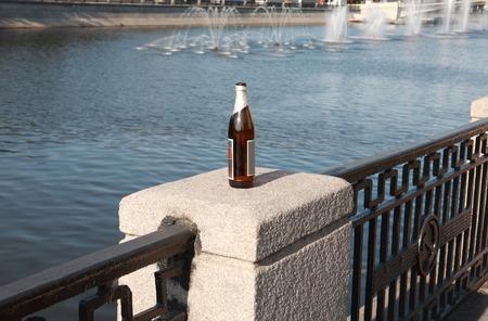 bottle on fence stone  column Stock Photo
