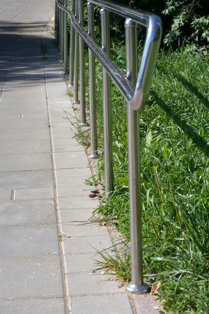 metal fence in park at dry sunny summer day 版權商用圖片