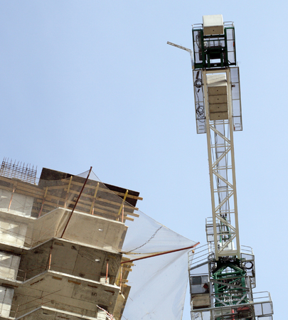 house develop with crane at day