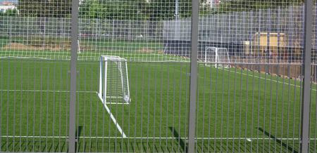 football field near fence at day sunny day