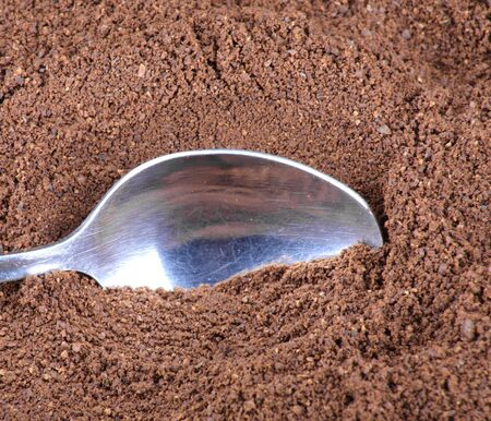 milled coffee background  and teaspoon