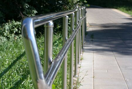 metal fence in park at dry sunny summer day Archivio Fotografico